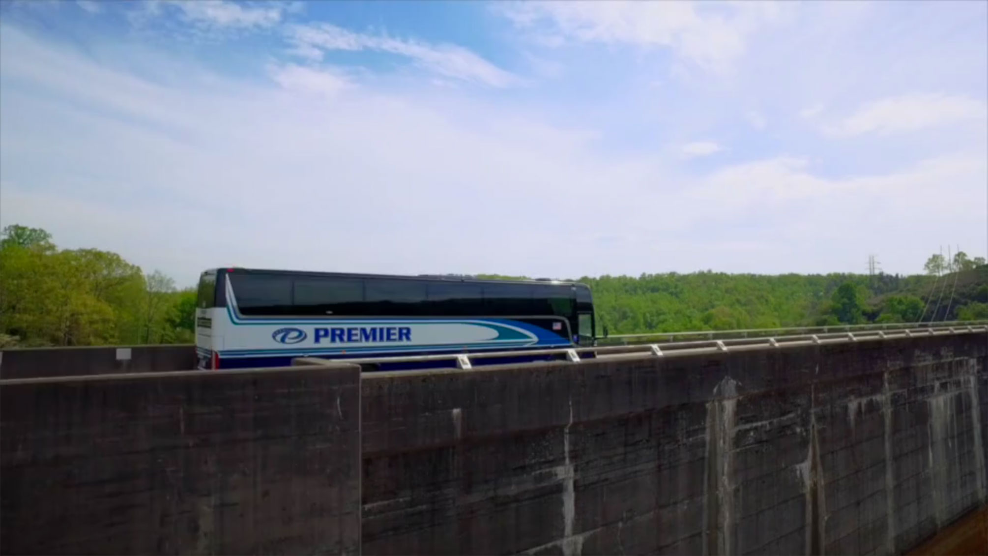 Premier Transportation Bus Over Bridge